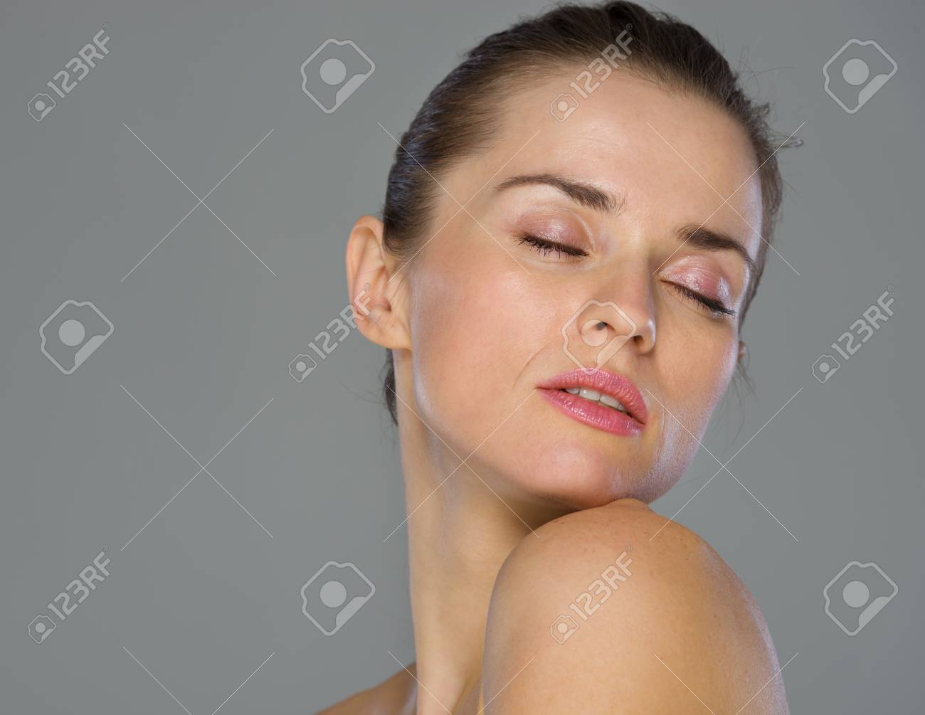 Beauty portrait of young woman isolated on gray background Stock Photo - 19848832