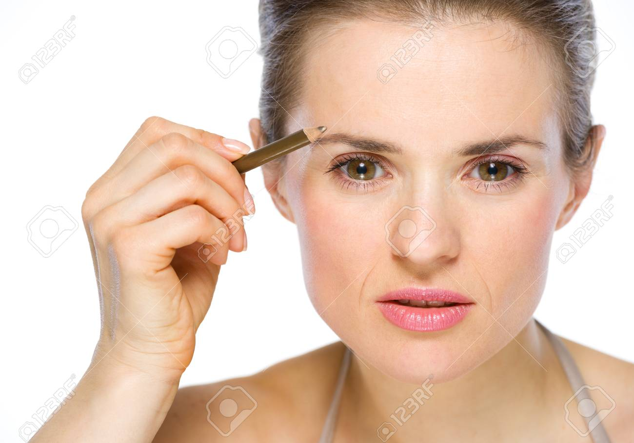 Beauty portrait of young woman applying brown eye liner Stock Photo - 19848825