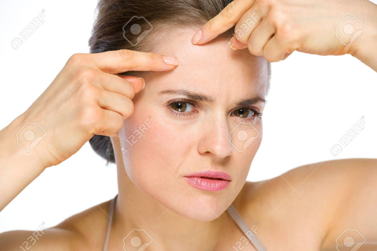 Beauty portrait of young woman squeezing acne Stock Photo - 19848833