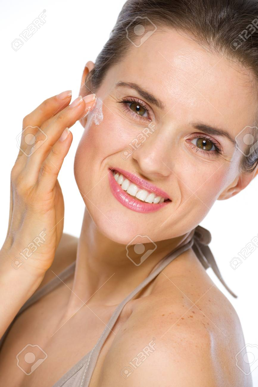 Beauty portrait of happy young woman applying creme Stock Photo - 19848843