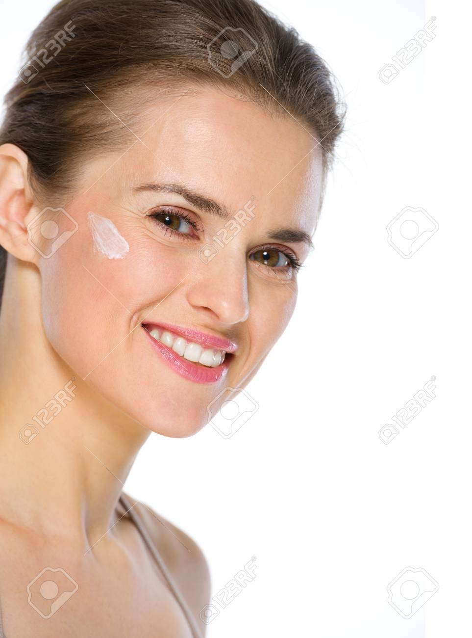 Beauty portrait of happy young woman with creme on cheek Stock Photo - 19848824