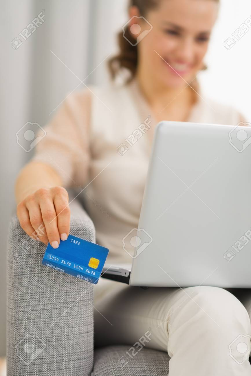 Closeup on credit card in hand of woman using laptop Stock Photo - 19983011