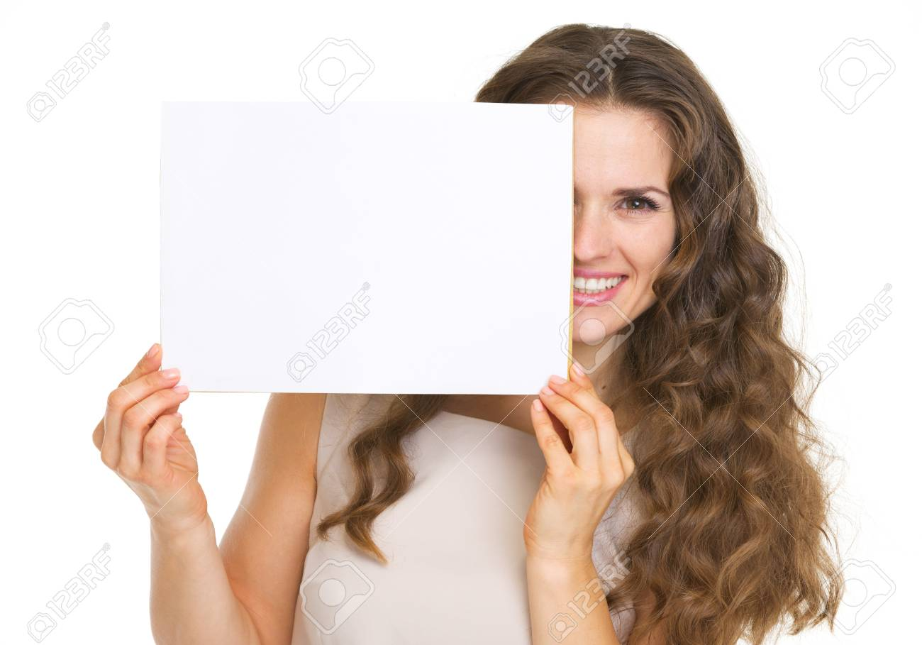 Portrait of happy young woman hiding behind blank paper Stock Photo - 20671417
