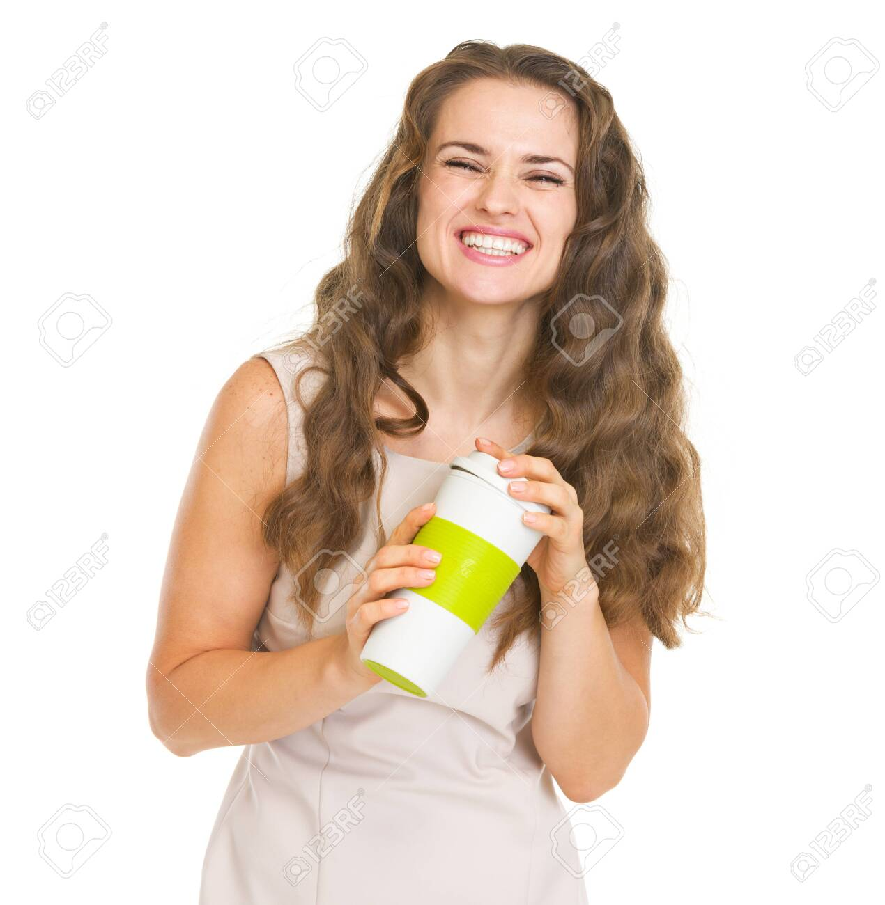 Portrait of smiling young woman with cup of hot beverage Stock Photo - 20857128