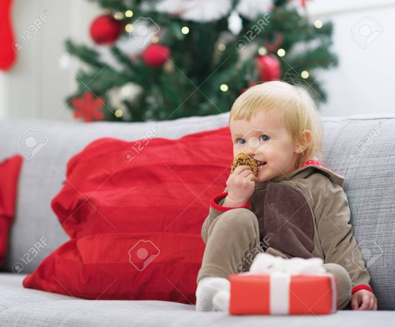 Happy baby in christmas costume eating cookie Stock Photo - 21353199