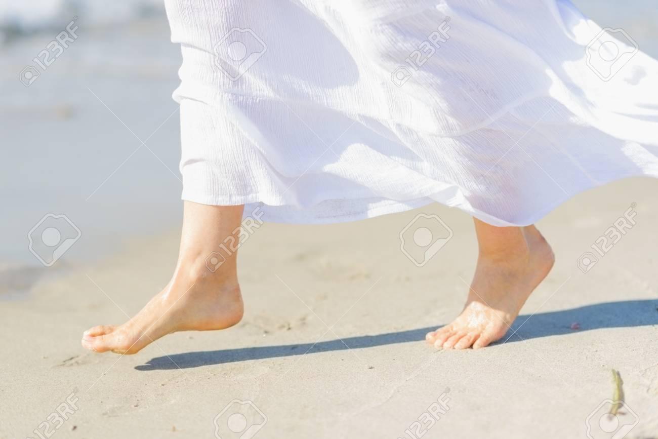 Closeup on leg of young woman on sea coast Stock Photo - 21338337