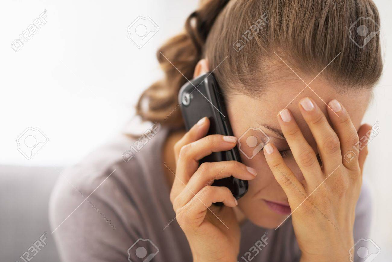 Stressed young woman talking mobile phone Stock Photo - 21359702