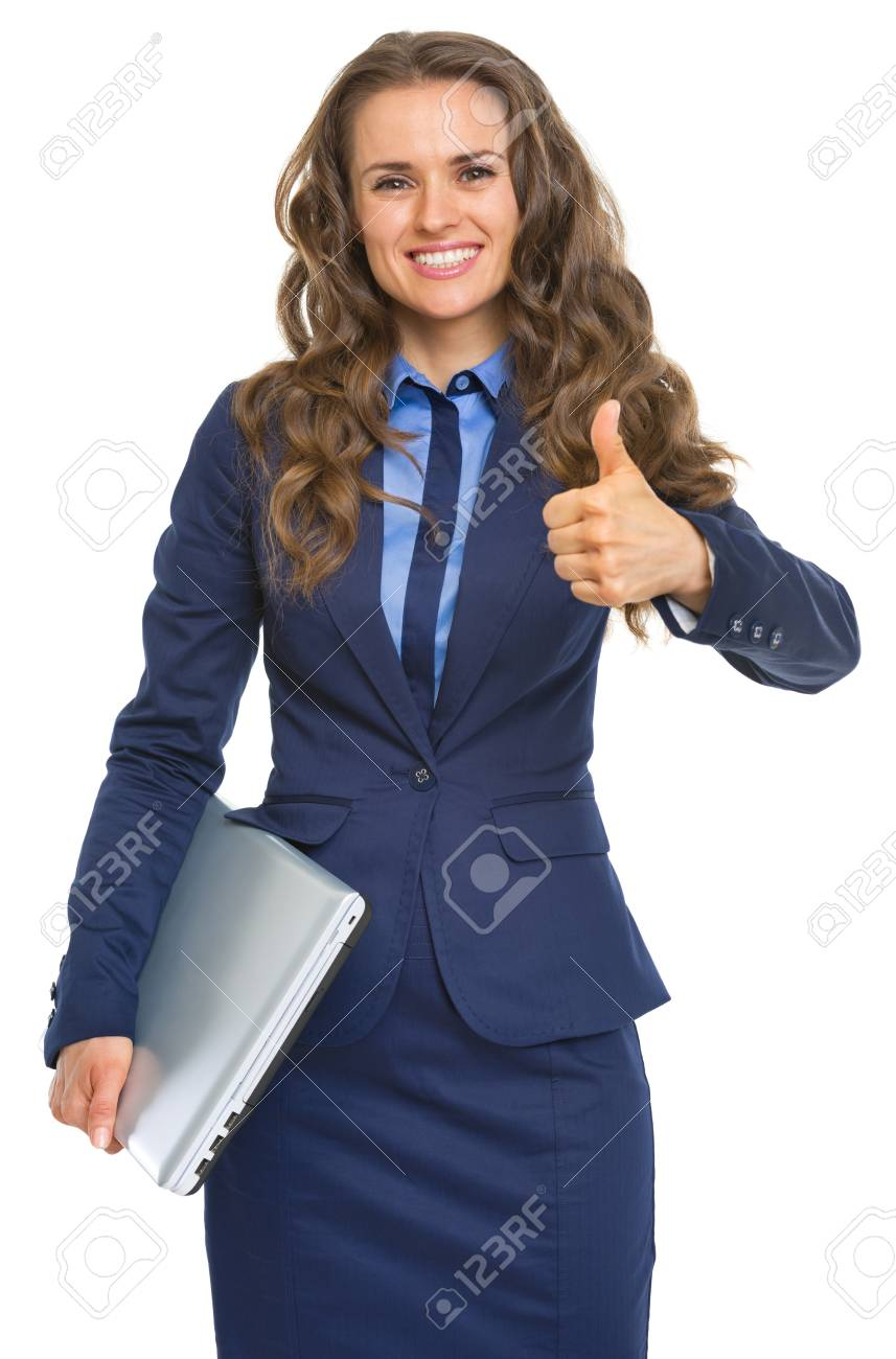 Portrait of smiling business woman with laptop showing thumbs up Stock Photo - 22887781