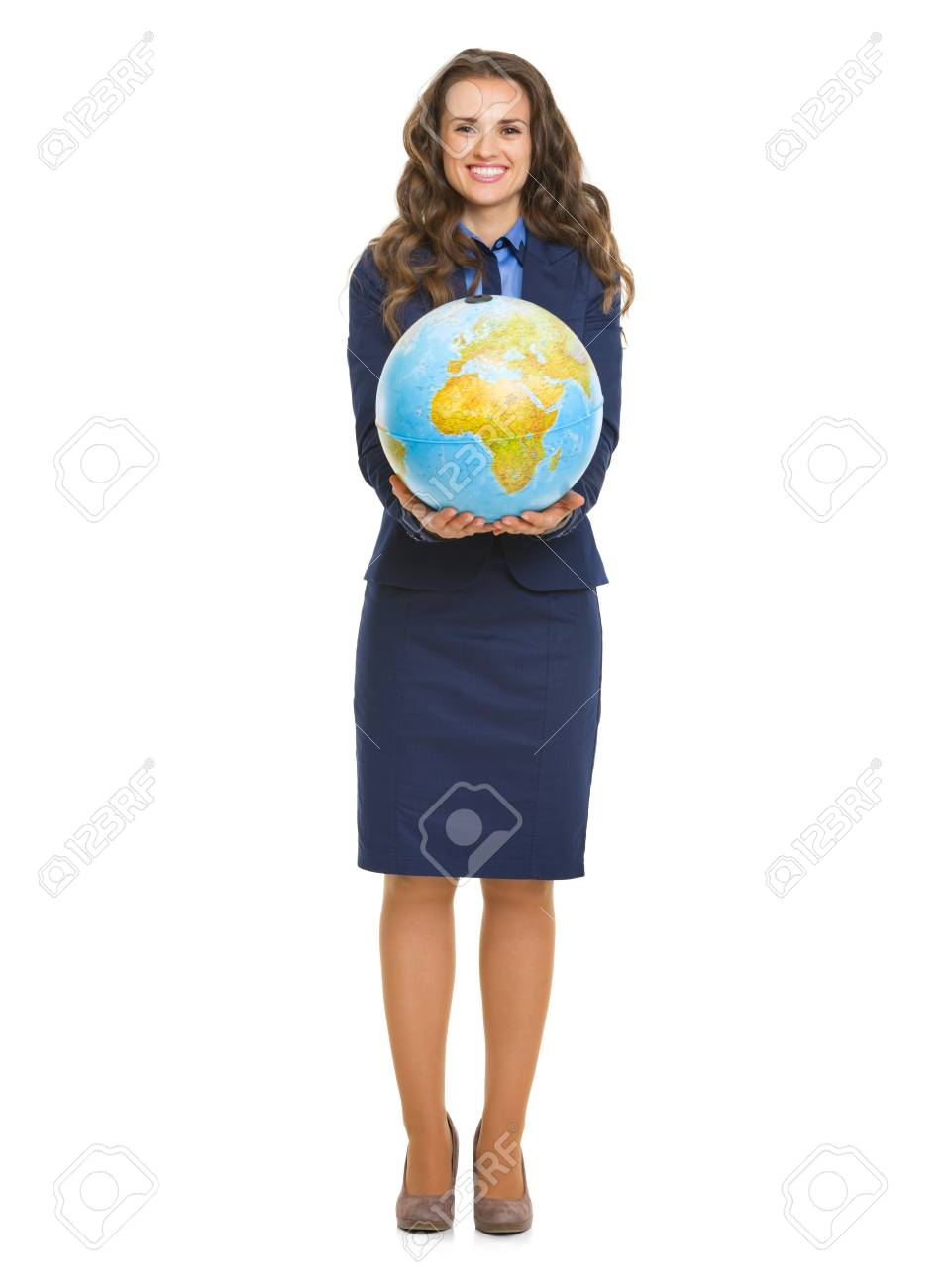 Full length portrait of smiling business woman showing globe Stock Photo - 22887806