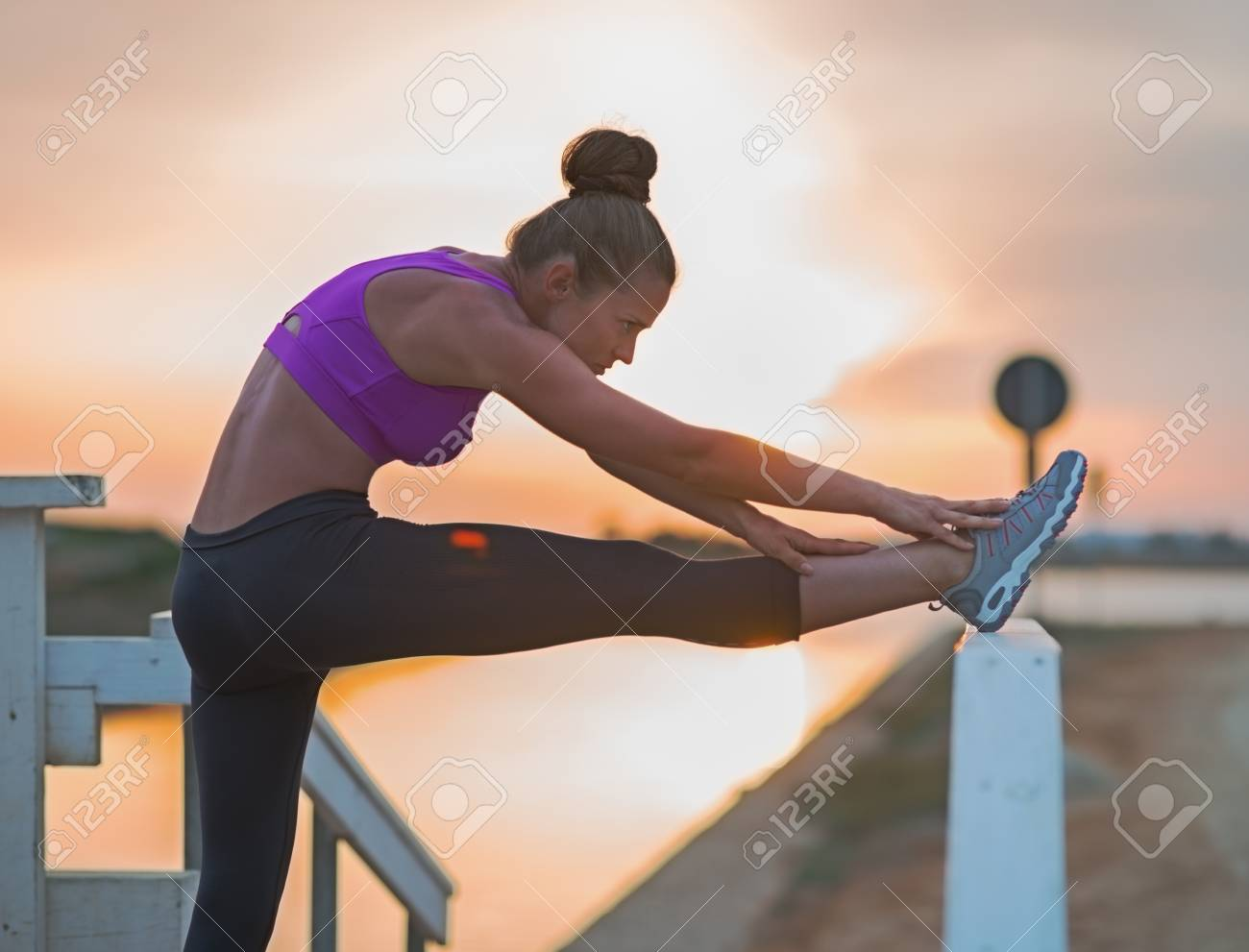 Fitness young woman stretching outdoors in the evening Stock Photo - 23537190