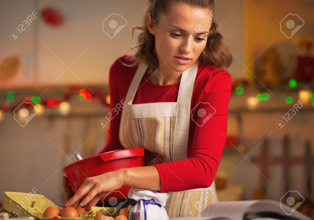 Young Housewife Preparing Christmas Dinner In Kitchen Stock Photo ...