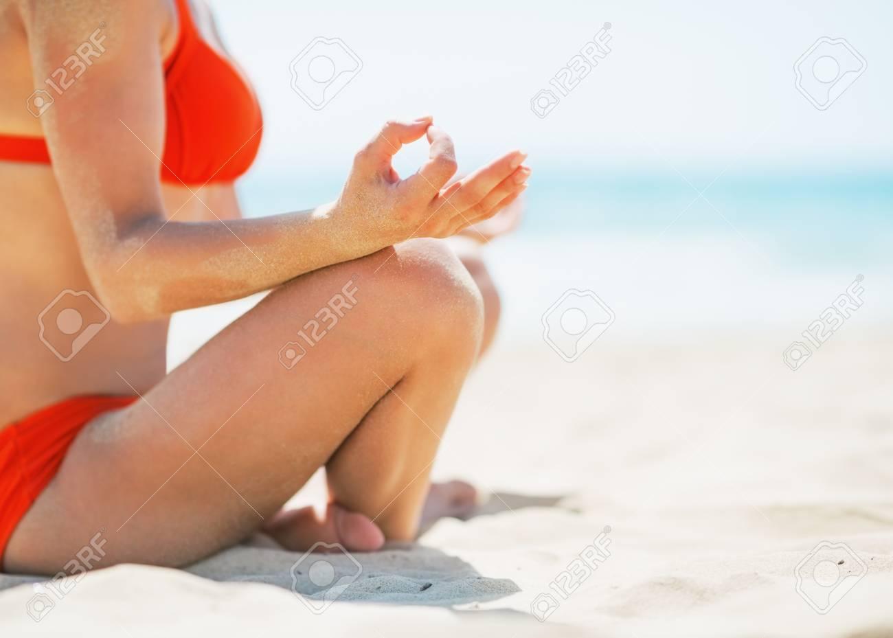 Closeup on young woman meditating on beach Stock Photo - 24913624