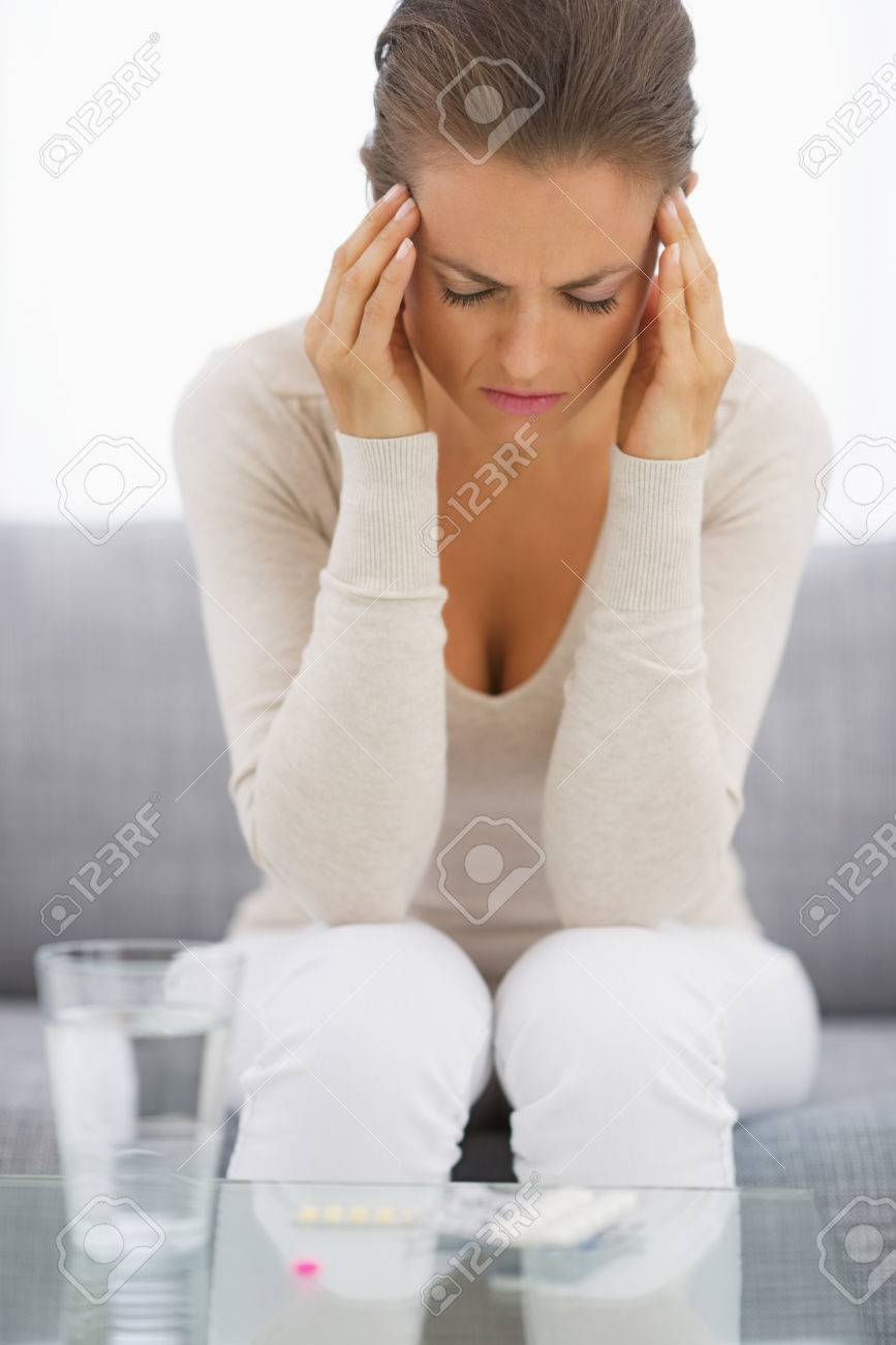 Portrait of stressed young housewife in living room Stock Photo - 25398011