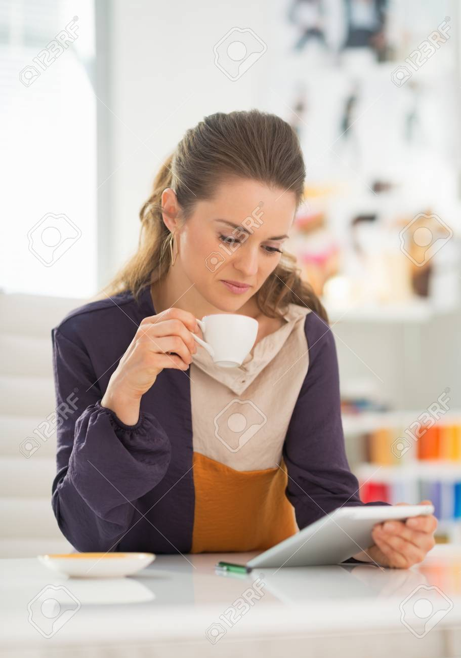Fashion designer using tablet pc at work Stock Photo - 27226002