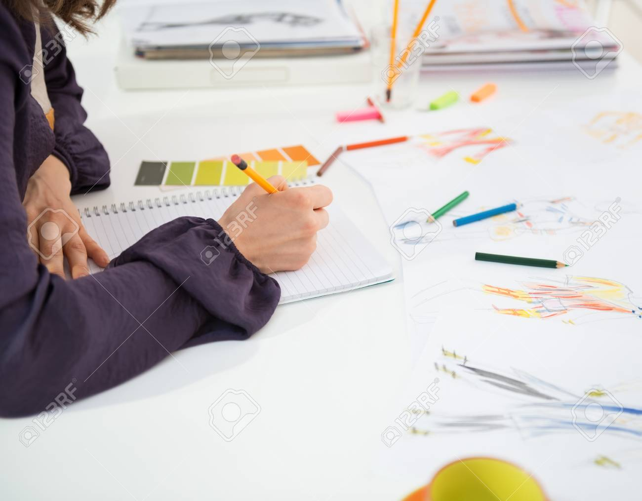 Closeup on fashion designer making sketches in office Stock Photo - 28357838