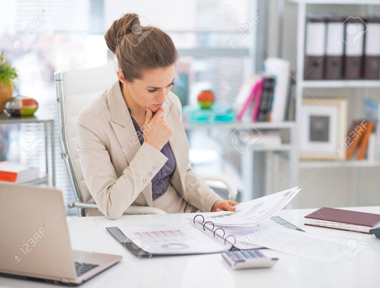 Thoughtful business woman documents in office Stock Photo - 29947776
