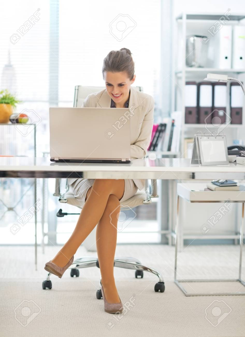 Business woman working on laptop in office Stock Photo - 29996961