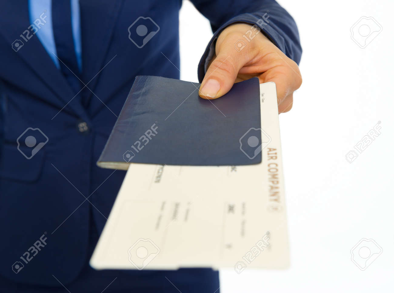 Closeup on business woman giving passport with ticket Stock Photo - 30683844