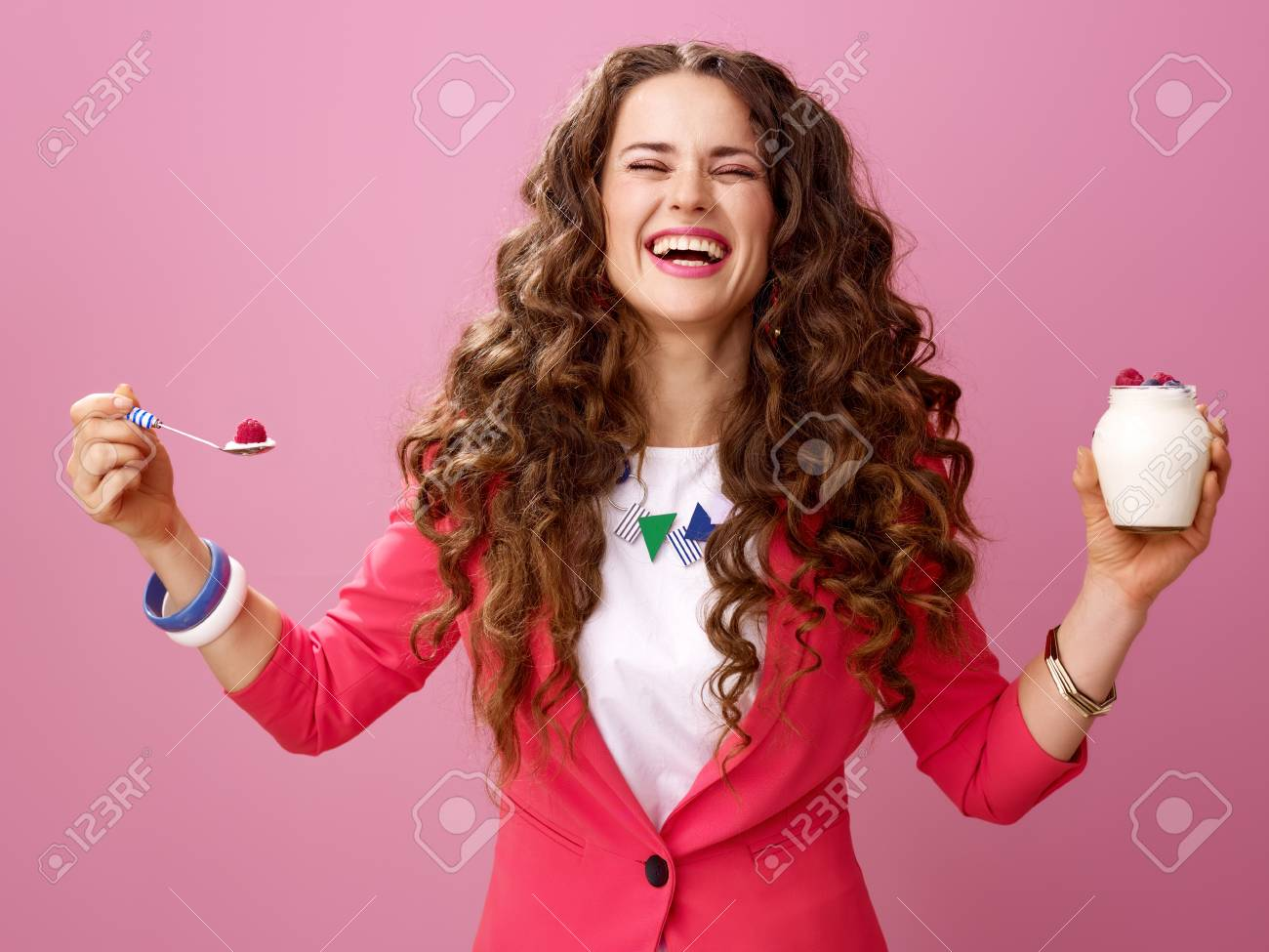 Pink Mood. happy young woman with long wavy brunette hair isolated on pink with farm organic yogurt - 96652087