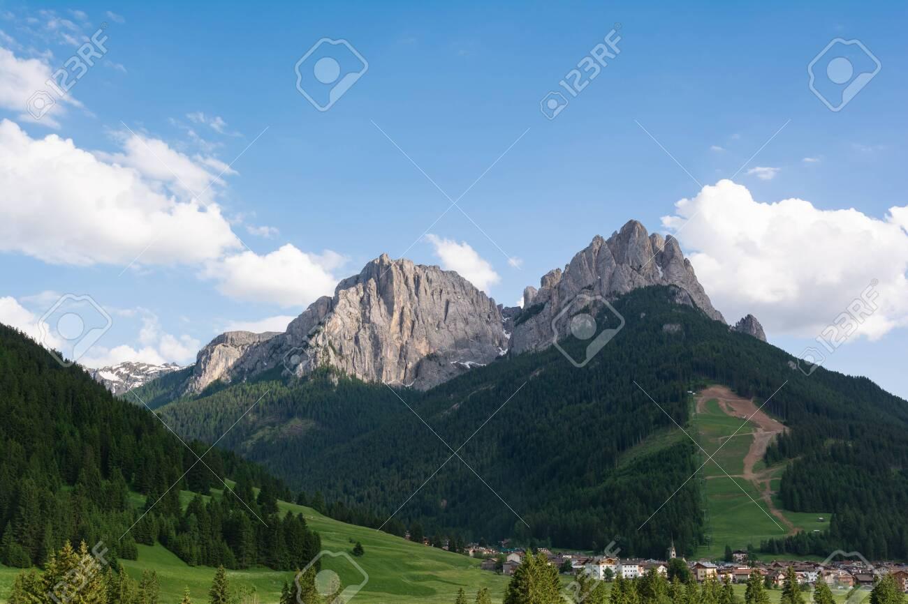 Pozza di Fassa village at the foot of Dolomites. Val di Fassa, Italy - 127399134