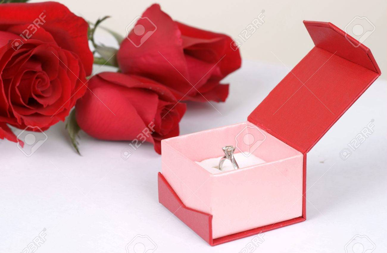 Diamond ring in box and red rose Stock Photo - 10510466