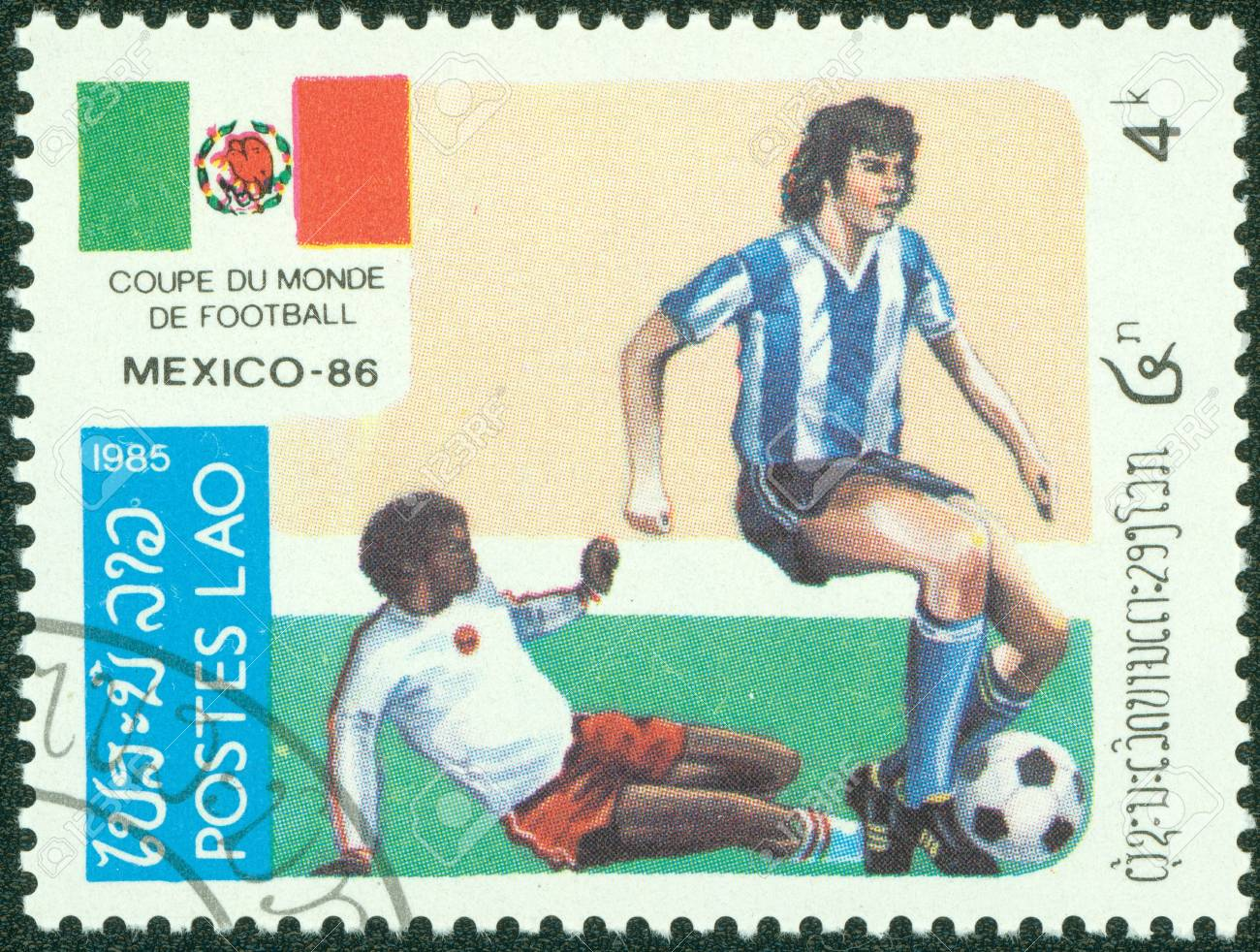 LAOS - CIRCA 1985  A Stamp printed in LAOS shows the Soccer Players, Football Field and flag of Mexico, series, circa 1985 Stock Photo - 14762944