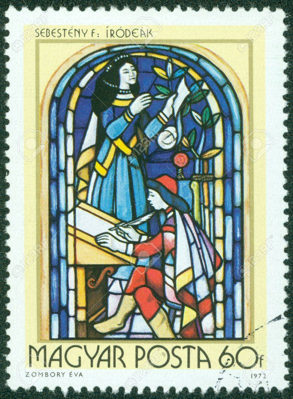 HUNGARY - CIRCA 1972  A stamp printed in Hungary, shows Stained-glass Window, 16th century scribe, by Ferenc Sebesteny, circa 1972 Stock Photo - 14830361