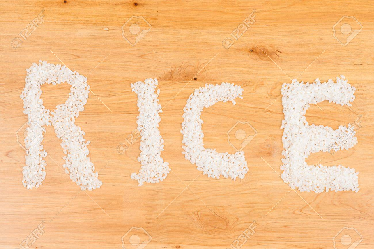 rice on wooden board form a pattern of word  rice Stock Photo - 16622274