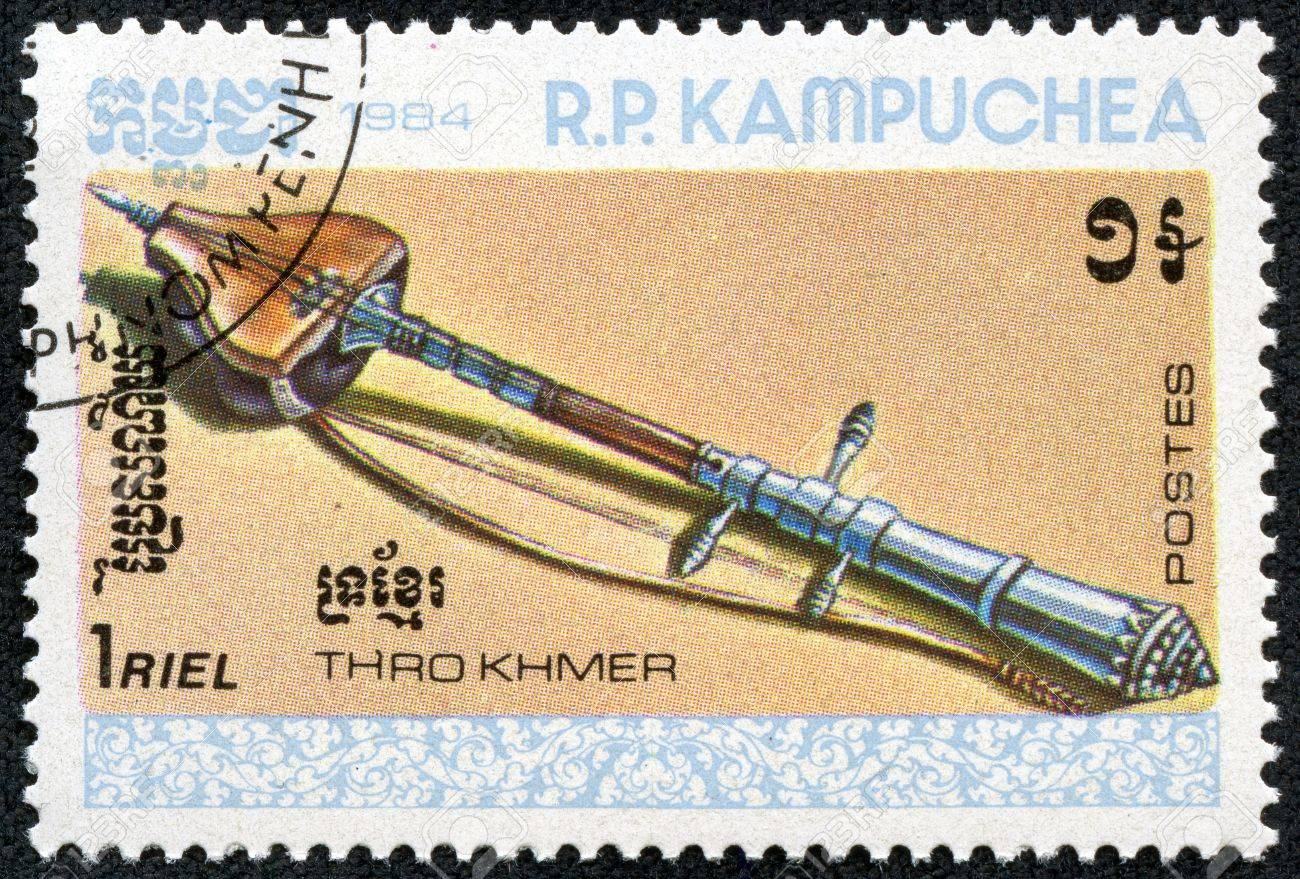 KAMPUCHEA-CIRCA 1984  A stamp printed in the Cambodia, shows a traditional musical instrument Thro khmer, circa 1984 Stock Photo - 17560900