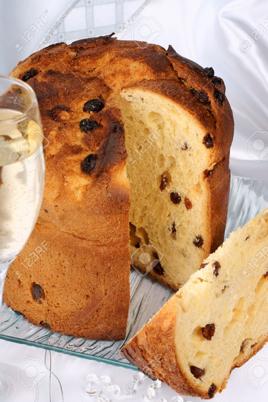 Italian christmas ornaments - Panettone The Italian Christmas Fruit Cake Served On A Transparent Glass Plate A Glass Of