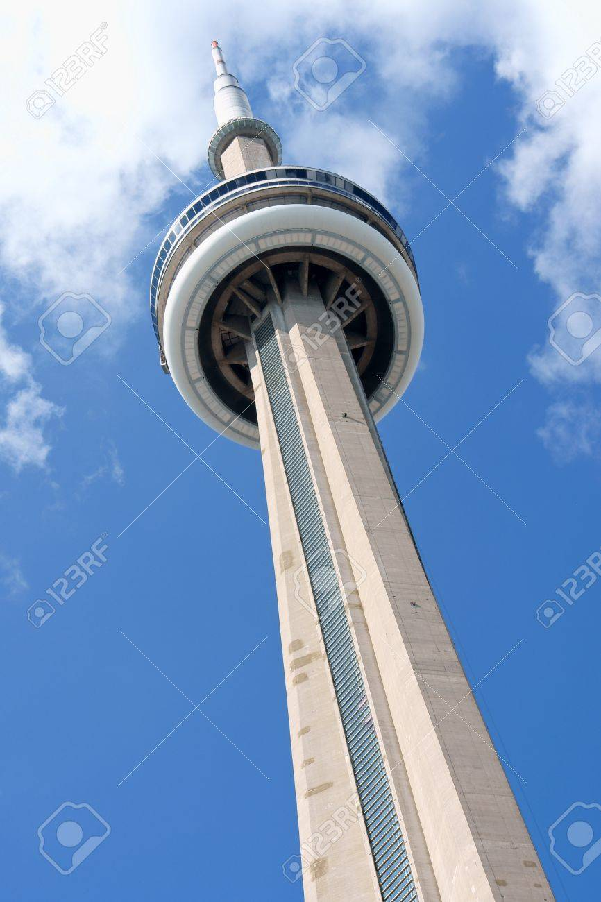 Toronto, Canada - August 01st 2008: CN Tower against a cloudy sky. It is one of the symbols of Canada with its 553.33 metres (1,815.4 ft) height. The name of this communications and observation tower, refers to Canadian National railway company who built  Stock Photo - 16425412