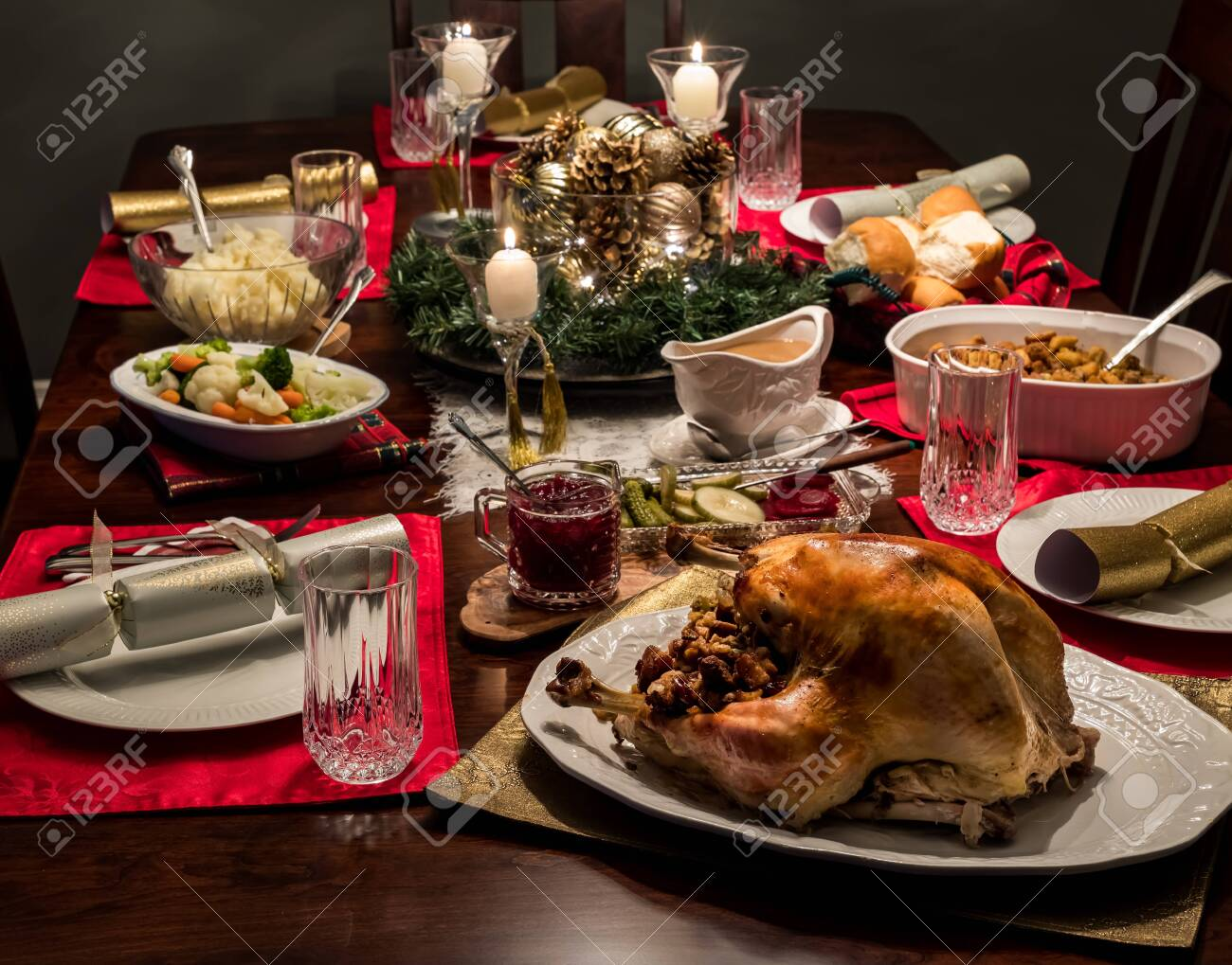 Close up of a Christmas dinner table complete with turkey and all the fixings including gravy and cranberry sauce. - 136488771