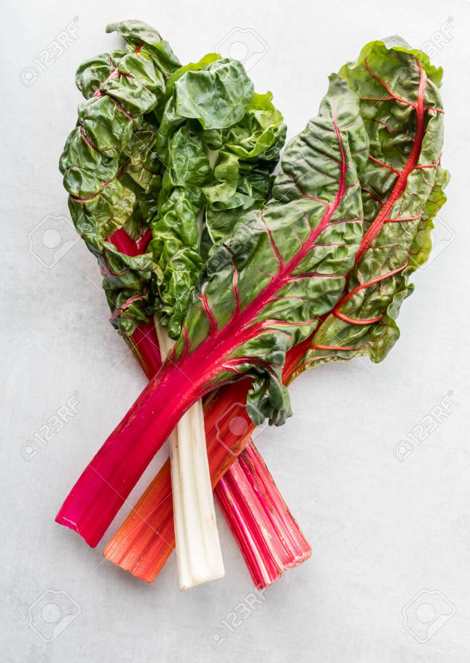 An Arranged Flat Lay View Of Four Rainbow Swiss Chard Leaves Stock Photo Picture And Royalty Free Image Image 139539789