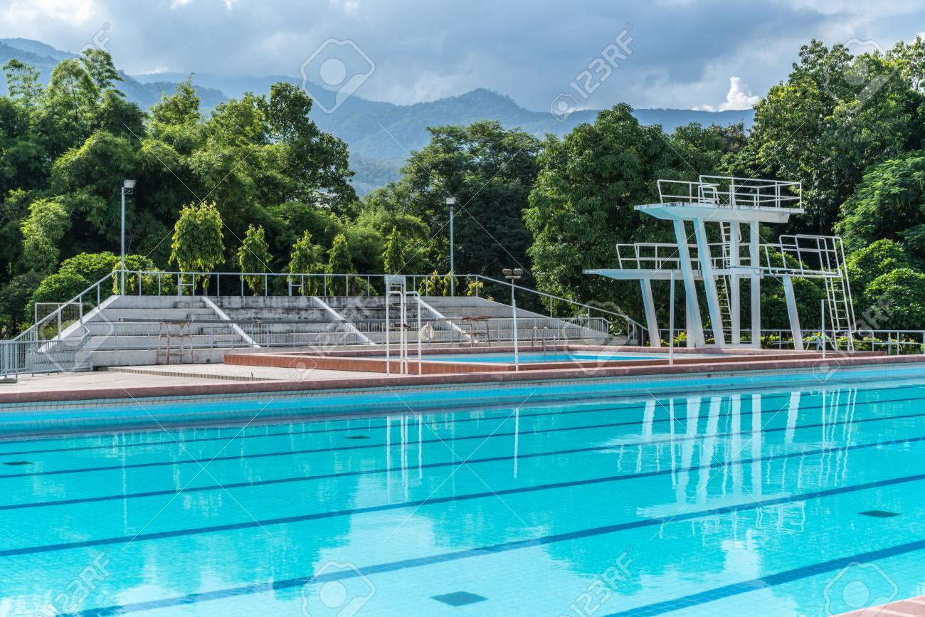 Swimming pools with diving board and grandstand