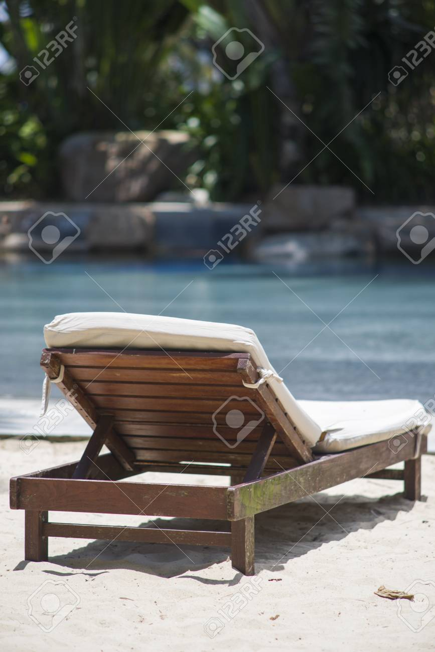 Outdoor lounge chair by a swimming pool