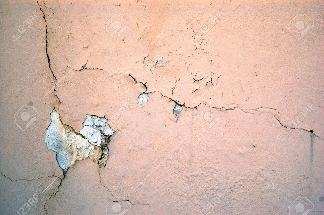 A cracked light pink grunge concrete background Stock Photo - 7654967