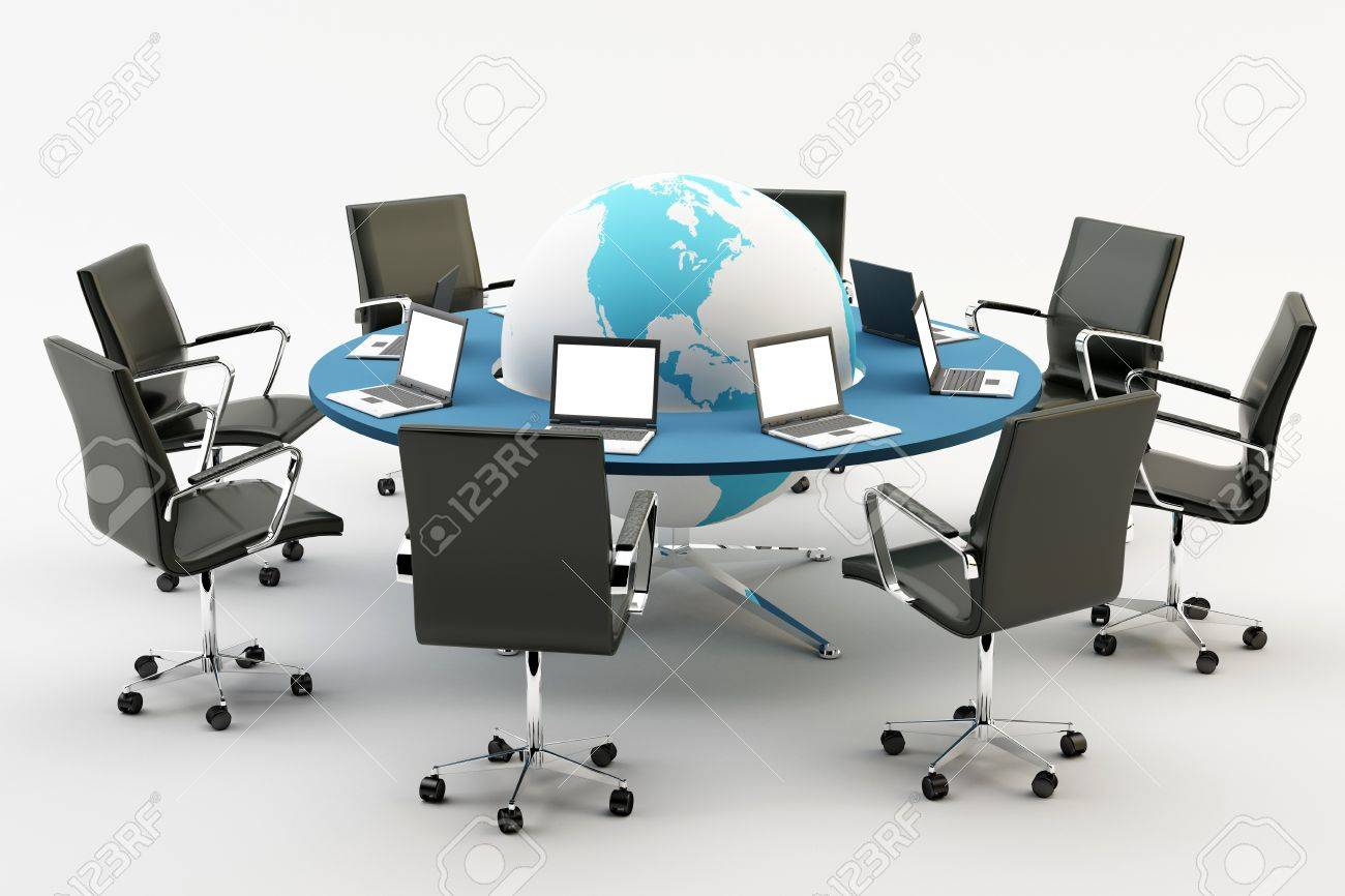 Black chairs around a light office table with world an pc Stock