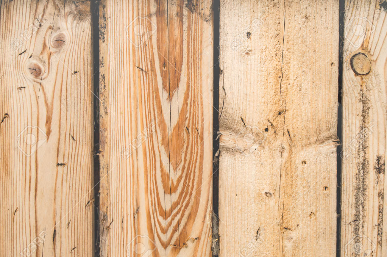 New planed boards, wood texture with cracks and knots, wooden background. - 168986476