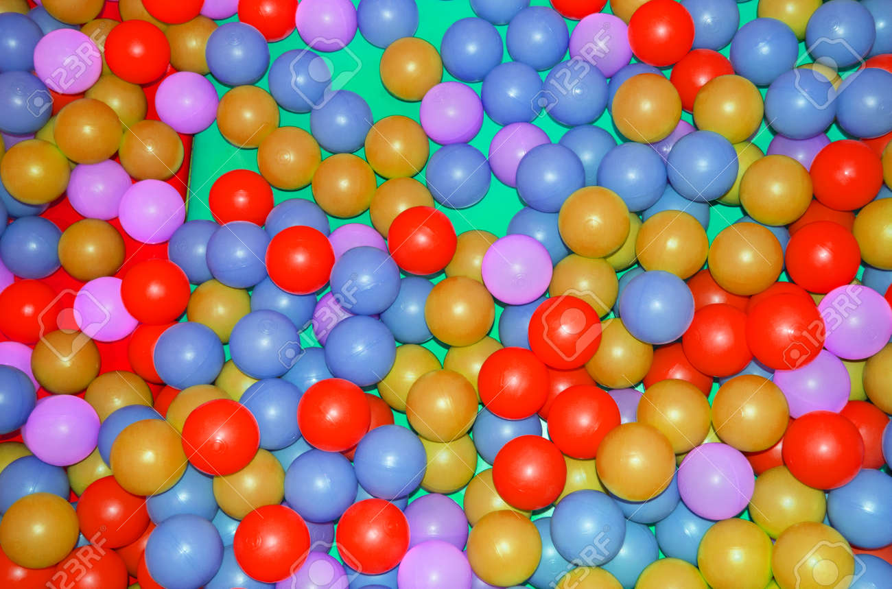 Background, colorful plastic colorful balls on the playground, pool with balls for children's development and games. - 169317192