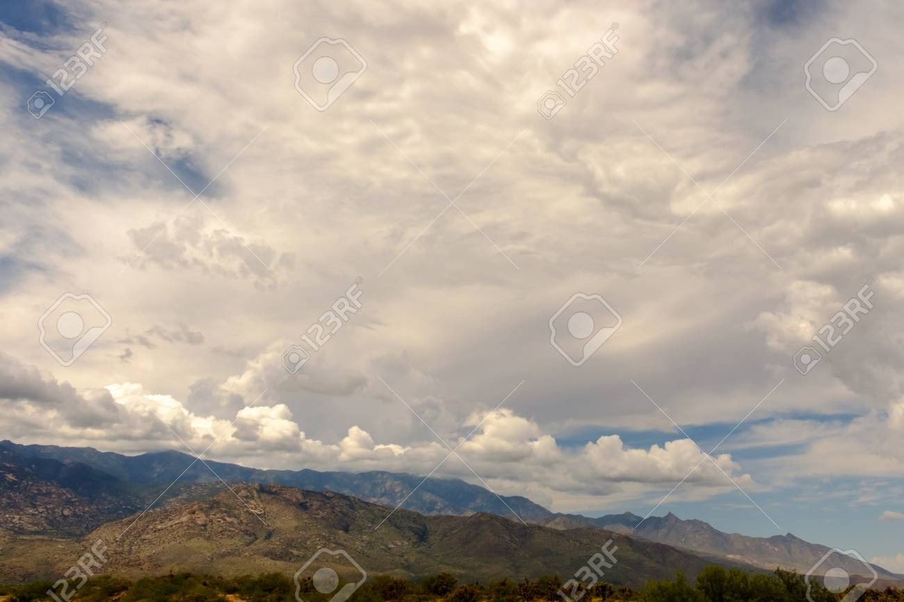 Banco De Imagens   Mountain In Lower Third Of Frame With Clouds And Blue Sky  At Top.