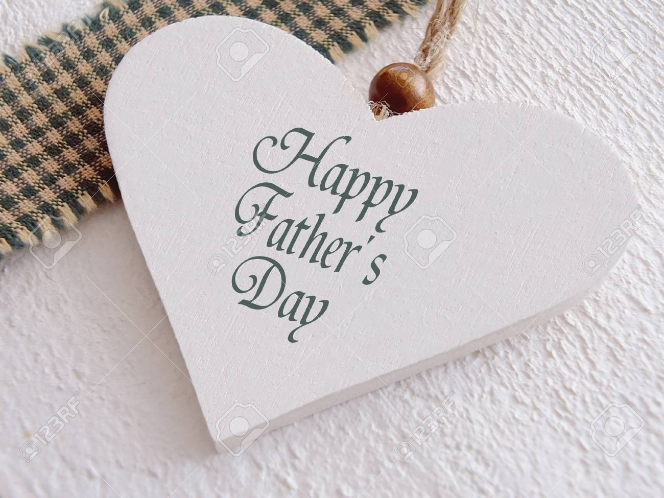 Wooden heart for fathers day Standard-Bild - 28074858
