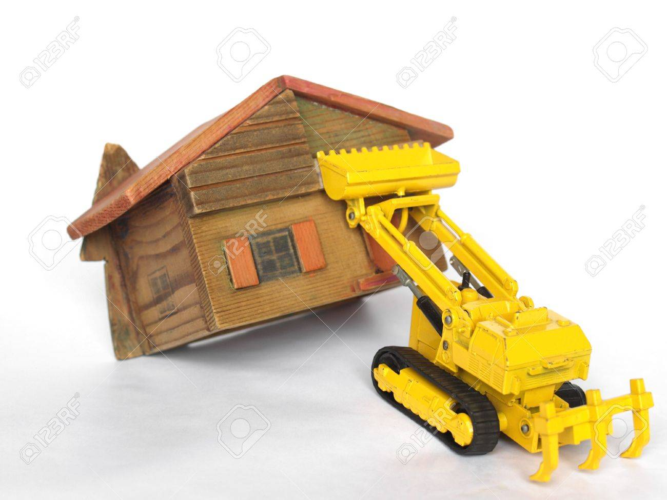 Eviction from house being demolished with bulldozer Stock Photo - 4142481