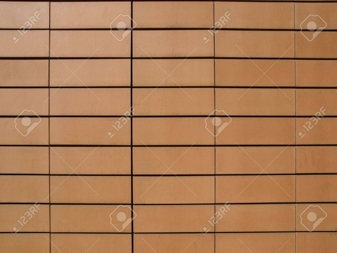 Orange ceramic terracotta tiles as a wall cladding stock photo orange ceramic terracotta tiles as a wall cladding stock photo 5877897 dailygadgetfo Choice Image