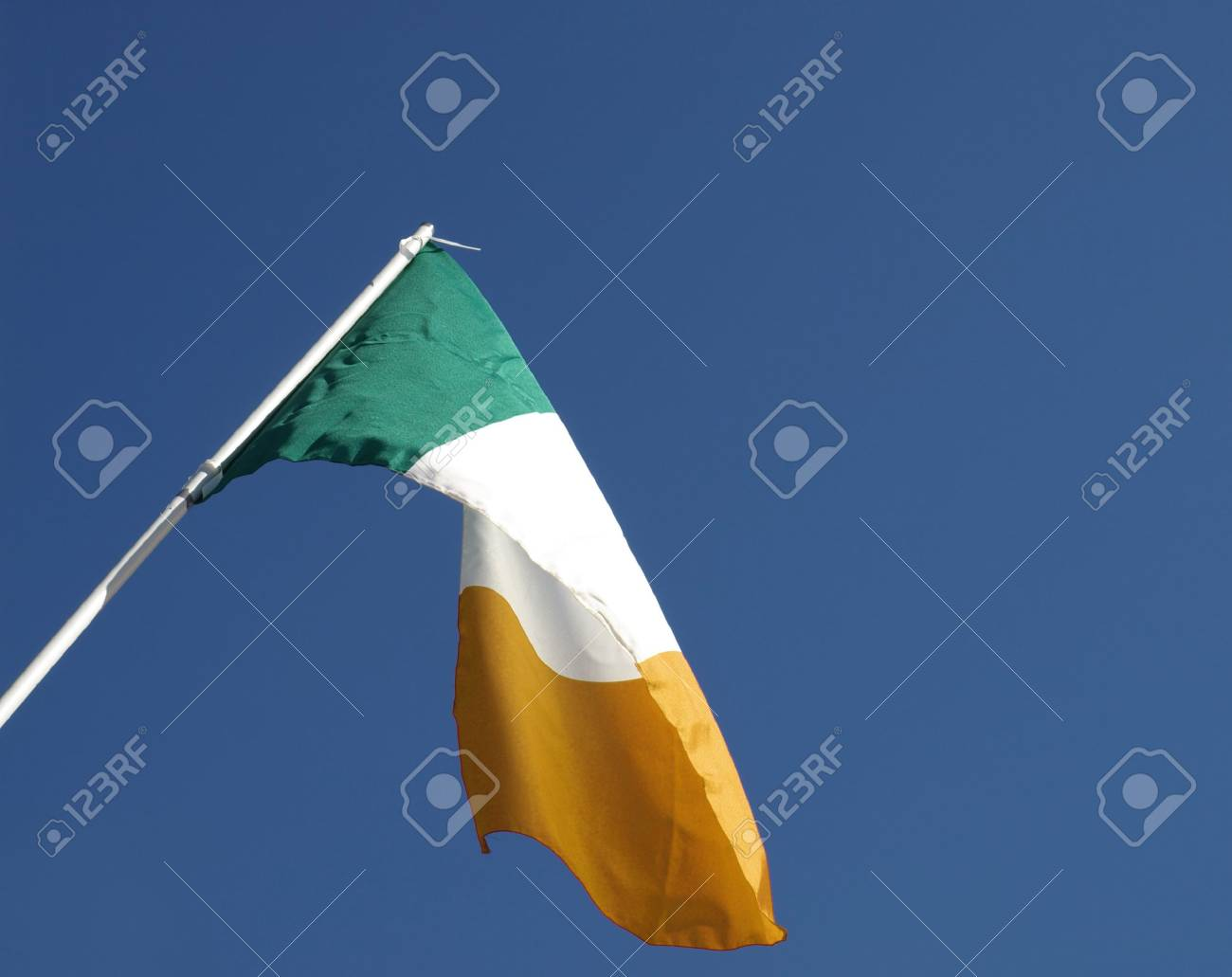 Irish flag over a blue sky background Stock Photo - 5942842