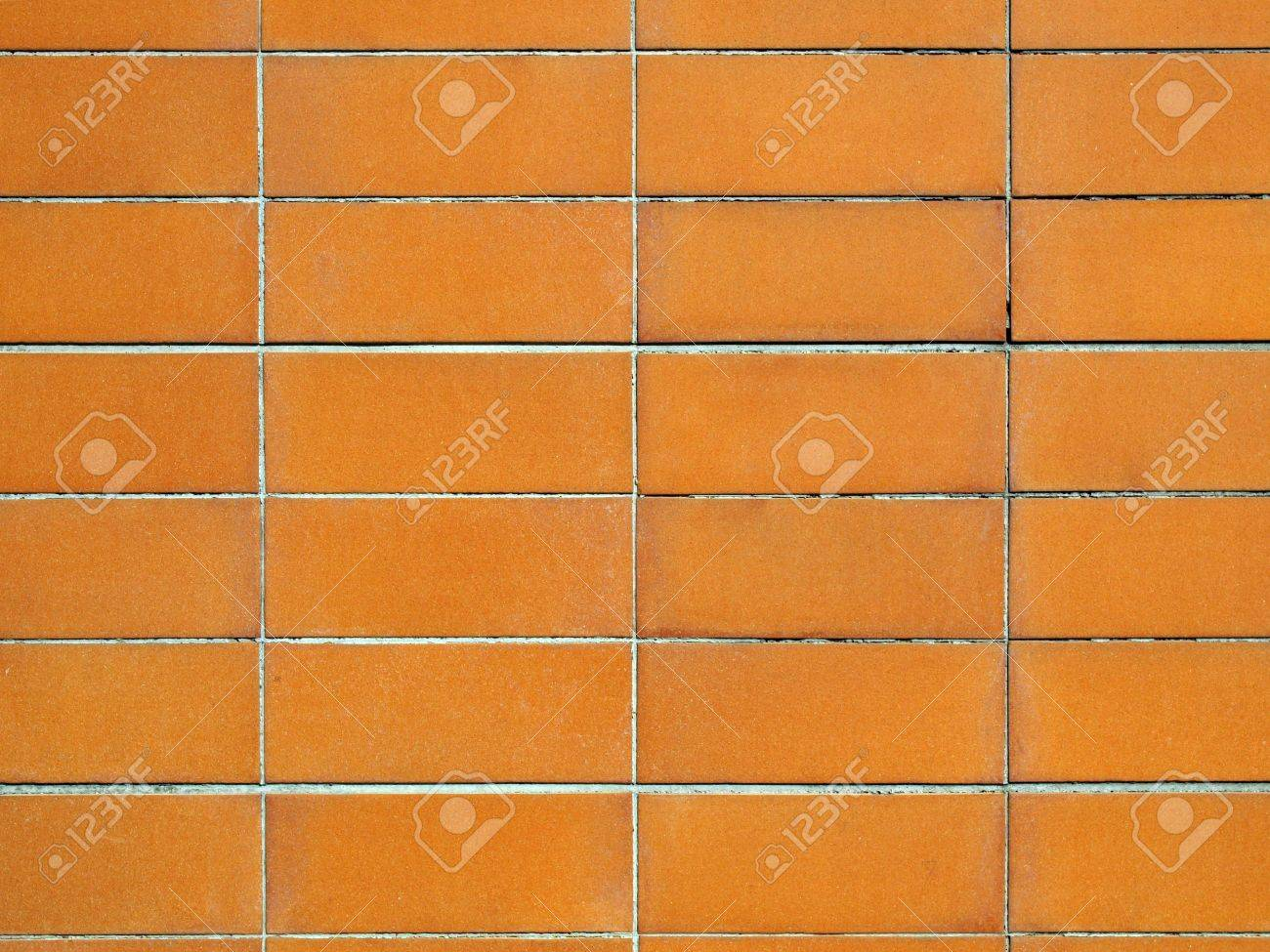 Orange terracotta ceramic tiles wall useful as background stock orange terracotta ceramic tiles wall useful as background stock photo 6027854 dailygadgetfo Image collections