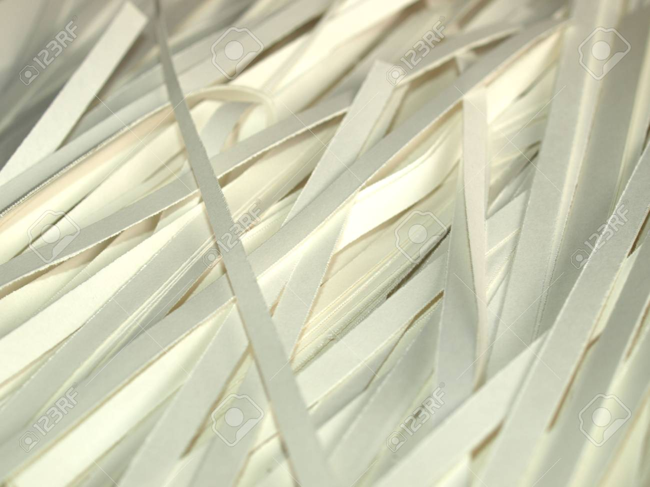 Paper documents cut into strips with a paper shredder Stock Photo - 6577628