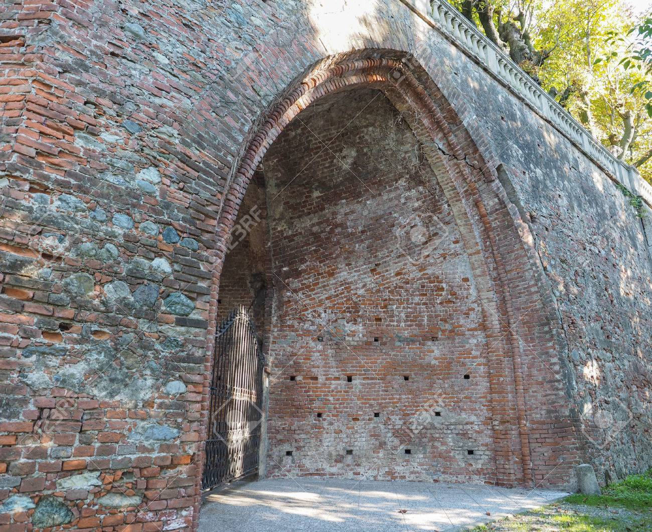 Ancient Gothic Arch Made Of Red Bricks Stock Photo