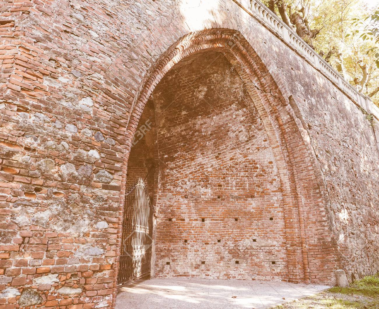 Ancient Gothic Arch Made Of Red Bricks Vintage Stock Photo