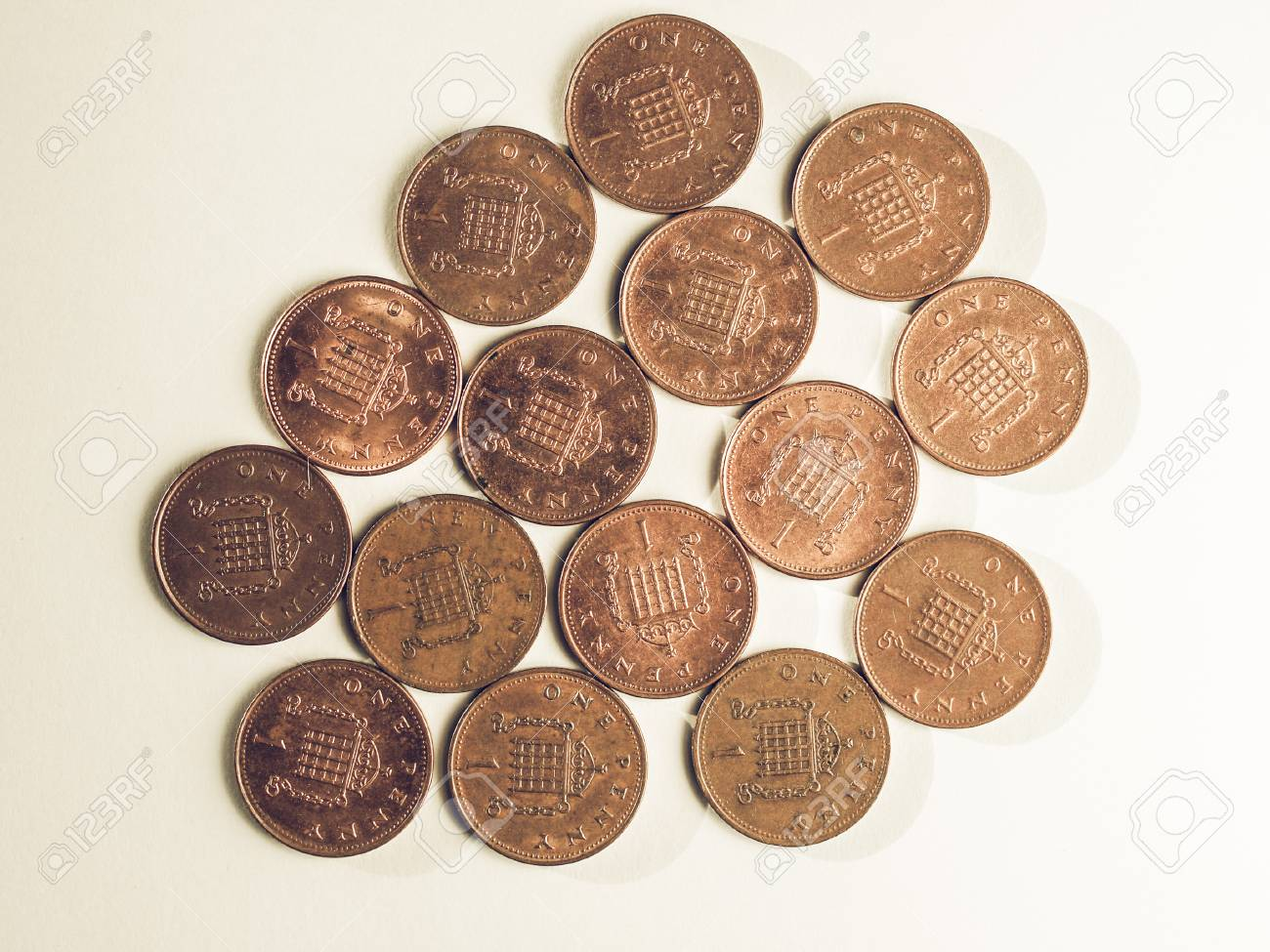 Vintage looking Many One Penny coins currency of the United Kingdom