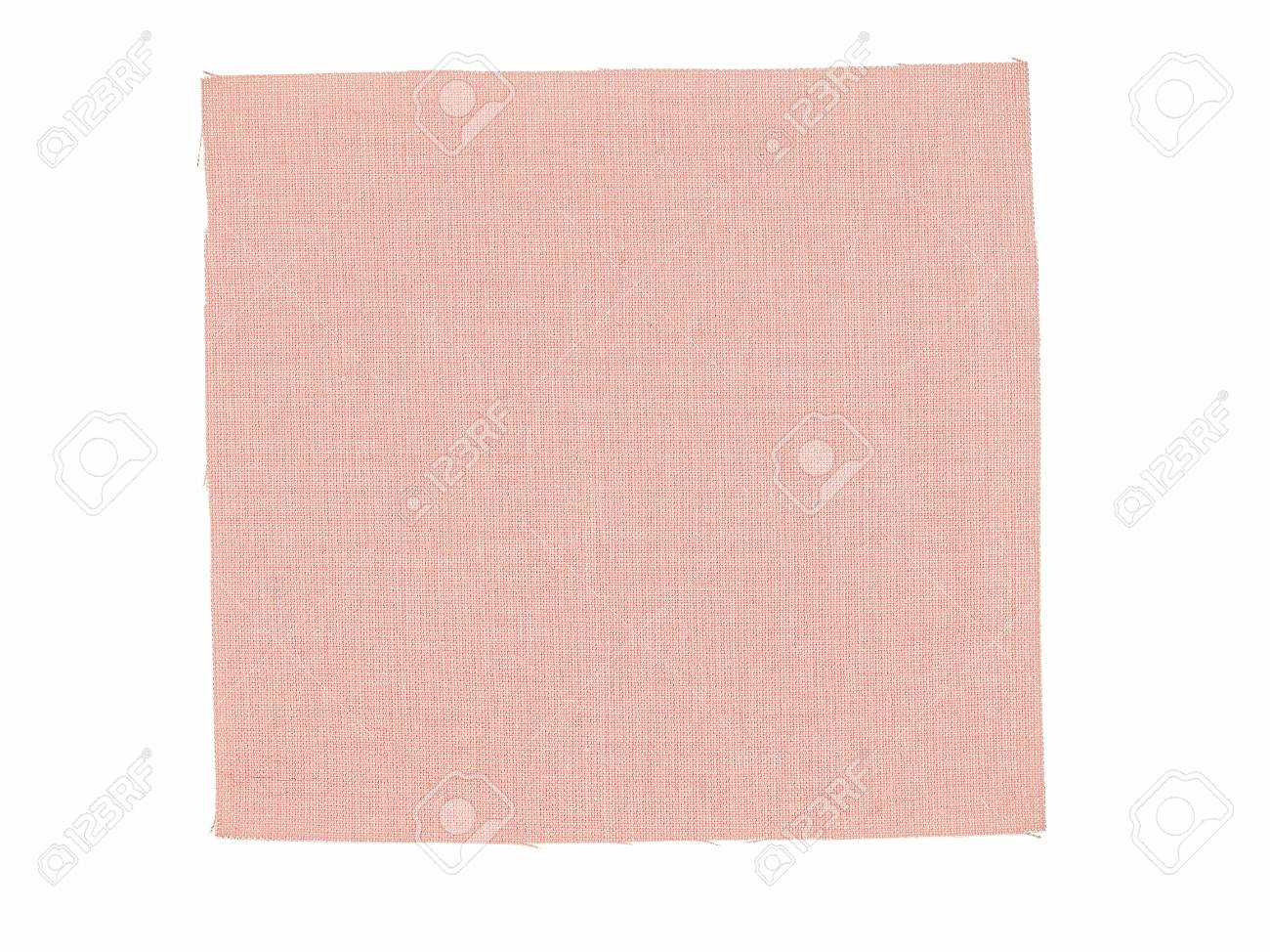vintage looking pink fabric swatch over white background stock photo